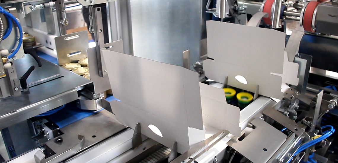 Wrap around case packer at Jakobsens Honey - Egatec Packaging Int.